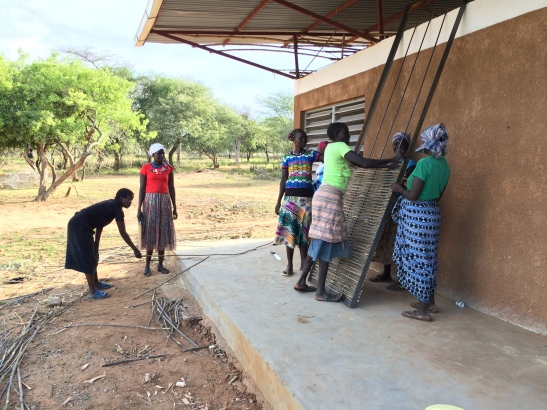 Pokot women were hired to create beautiful doors for the building in keeping with the style of the grain huts that women design on a regular basis. The women were ecstatic to participate in the project and have their art and creativity appreciated.